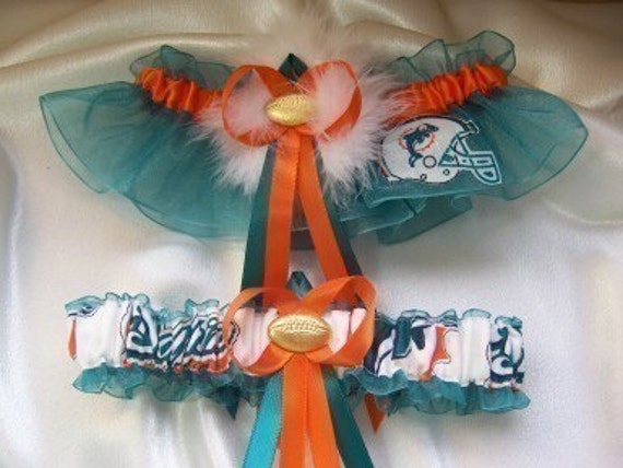 ... teal and orange ribbons, a sexy marabou pouf, and a football charm.