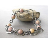 pink rhodonite bracelet with sterling wire wrap and metalwork - theBeadAerie