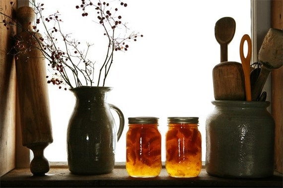 Marmalade - rustic farm scene with jars of orange marmalade.