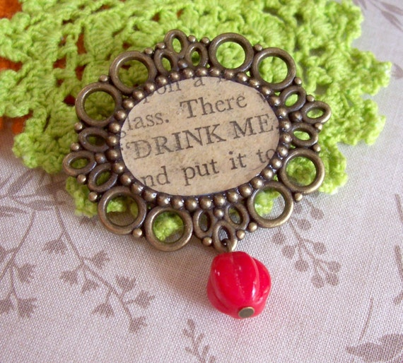 image alice in wonderland lewis carroll brooch bouquet pin bridal wedding drink me red two cheeky monkeys jewellery
