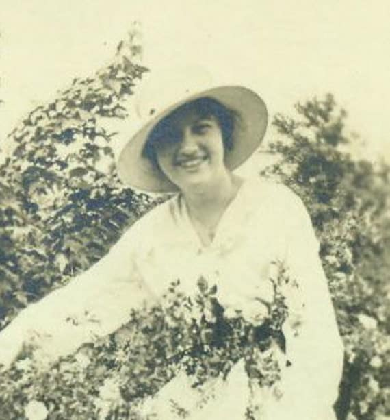 Vintage 1920s Photograph Woman in Garden Rose Bush White Dress Wide Rimmed Hat Spring Summer Black and White Photo 1920s