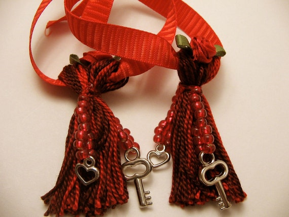 Pair of red beaded love tassels with keys and hearts