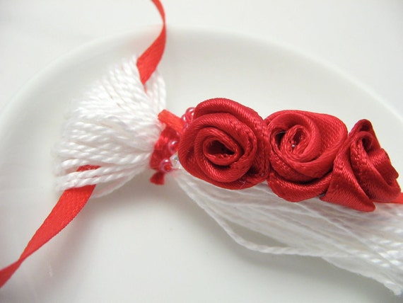 Red Ribbon Roses on White Tassel