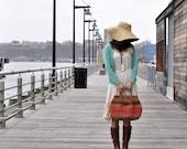 woven straw bag in warm earthy colors - klinker