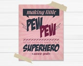 "Graphic Art Print ""Making Little Pew Pew Noises Instantly Makes You a Superhero"" in Antique Pink, Purple and Navy"