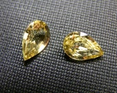 Very rare yellow Mali Garnets. A pair of pear shapes. 1.67 ct total. 2 loose gemstones. - DanPickedMinerals
