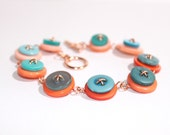 Orange and teal button bracelet - d2kgalleries