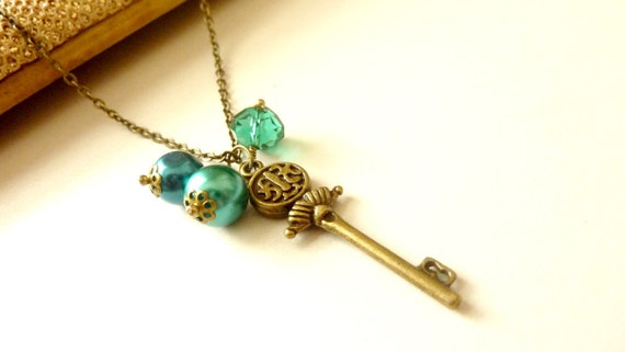 Vintage necklace brass charm scepter key chain with teal glass pearls and crystal beads