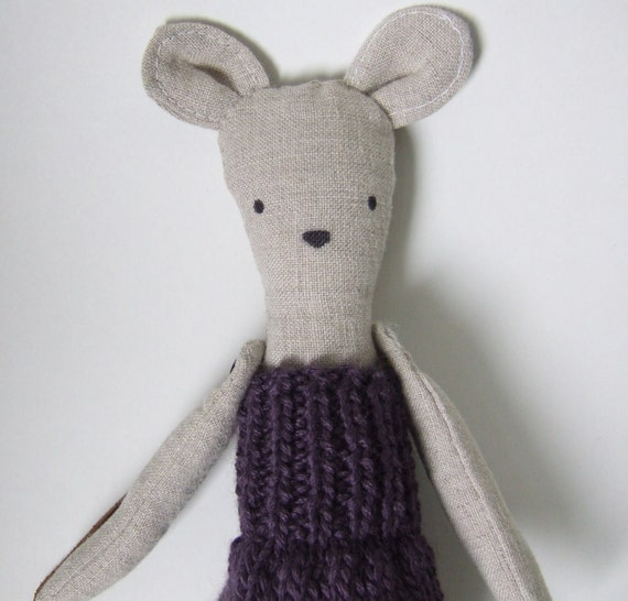 Penelope the linen mouse doll goes to school in her purple knit dress.