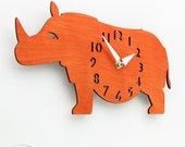 "The ""Rotund Rhino in Orange"" designer wall mounted clock from LeLuni - LeLuni"
