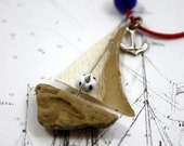 "driftwood sailboat necklace with sail from genuine parchment , it has an anchor from sterling silver and a life ring......""ship ahoy"" - Yalos"