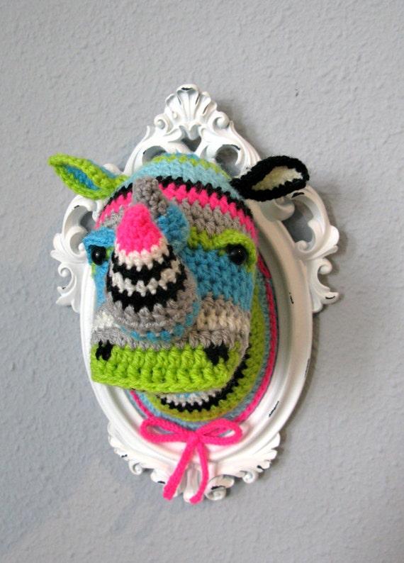 Crochet rhino head in a wooden white frame.