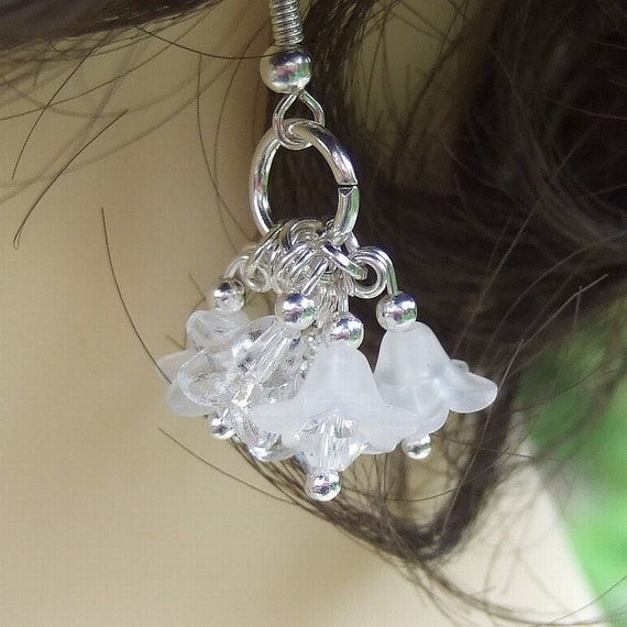 Miniature bouquets of flowers, wedding earrings in white and silver.