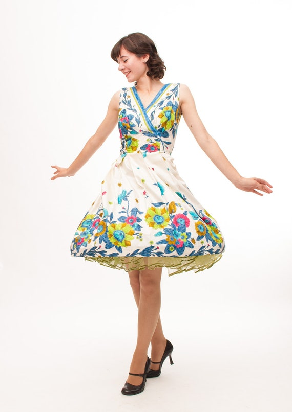 vintage floral dress with vee neck, high waist, and full skirt from the 1950s
