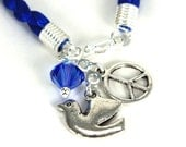 Royal Blue Braided Cord Bracelet with Peace Symbol, Peace Dove, and Capri Blue Swarovski Crystal - anjalicreations