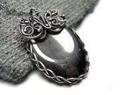 Wire wrapped silver pendant hand made necklace with titanium hematite stone, oval, gothic, victorian, luxury