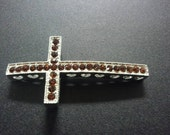 Silver with brown rhinestones sideways cross