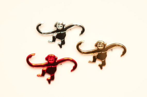 3 laser cut monkey brooches
