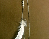 White feather earlace