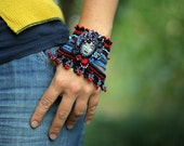 Crochet Cuff with Polymer Clay Face in Black, Red and Blue - ellisaveta