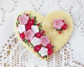 Soft Yellow Felt Heart Brooch with Spray of Pink, Raspberry, and White Flowers - glassbeadtreasures