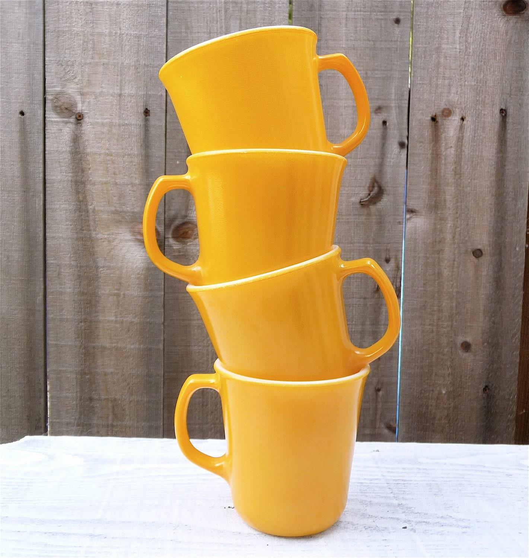 milk glass yellow mugs