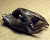 "2"" long small bronze hands with bronze screw eyes,"