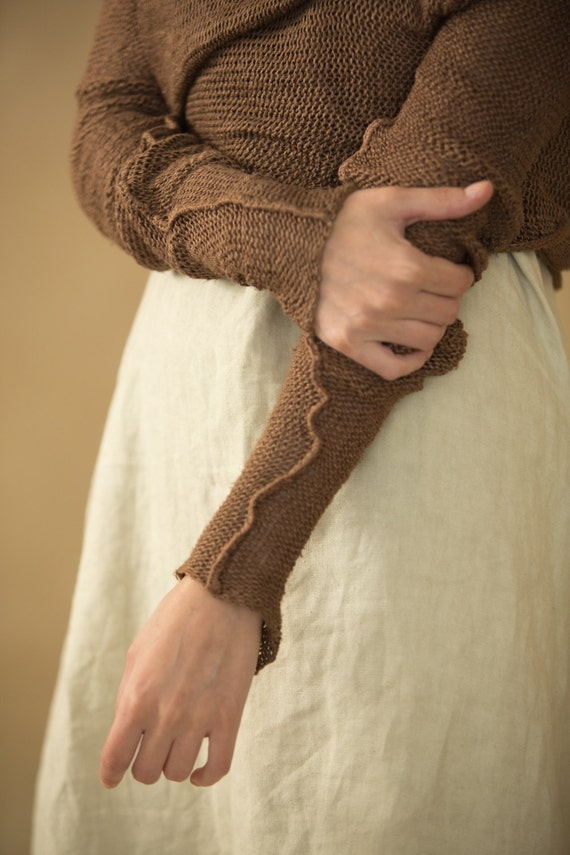 brown cardigan or,knit sweater