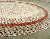 Recycled rag rug. Handmade crochet oval rag rug. Made with vintge, upcycled fabric. Brick, orange. - GladRaggz