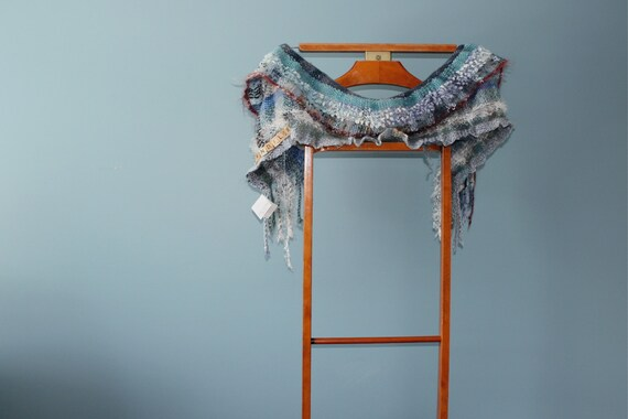 Ebb and Flow, a Short Wrap in blue grey with an edge of red mohair