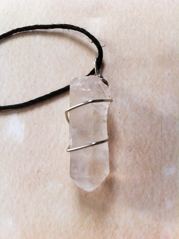 rina. tibetan wire-wrapped quartz point necklace