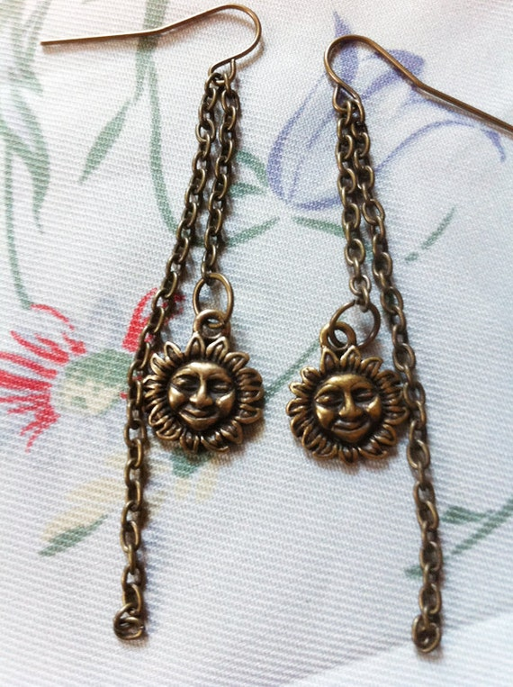 nina. brass sun & chain earrings.