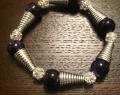 Bling bracelet purple and silver beads. Fits most wrists.