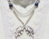 Lapis bead necklace with multiple silver chains and silver flower and leaf accents