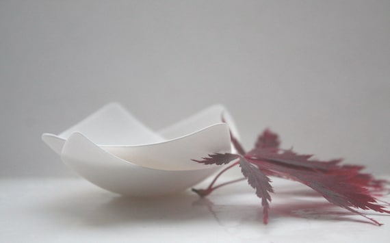 Set of 2 snow white stoneware English fine bone china vessels in an abstract boat shape.