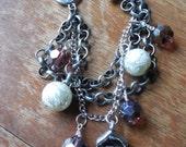 Multi-Strand Charm Bracelet with Flower, Bead, & Rhinestone Charms