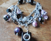 Multi-Strand Charm Bracelet with Clear and Black Beaded Strand