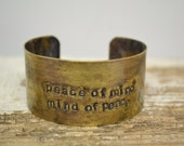 peace of mind mind of peace handstamped on brass cuff