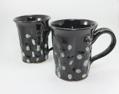 pretty pair of black patterned mugs sold together