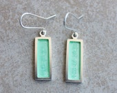Word earring with transparent mint enamel
