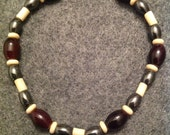 Hematite and stone beads. Fits most wrists. (Male)