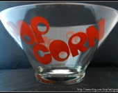 Large 1970s vintage round clear glass serving popcorn snack party bowl with red retro bubble font. Ready for movie night.