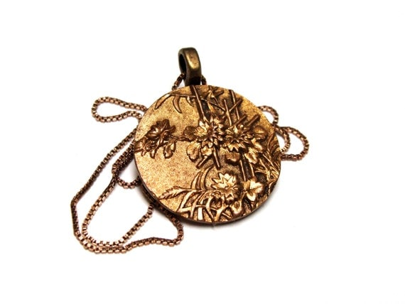 golden button jewelry necklace pendant with flowers in Asian theme