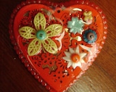 bright red assemblage heart brooch