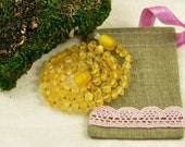 Baltic Amber Baby teething necklace lemon, unpolished, baroque beads in Lovely Linen gift bag