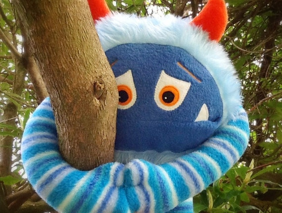 Blue Floyd, a cuddly fleece and faux fur stuffed monster toy who needs a loving family to adopt him