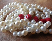 Set of Six Stretchy Bracelets Cream Colored Beads with One Red Bead on each