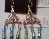 A Triquatre dangle with two shades of blue seed beads and Tibitian spacers.