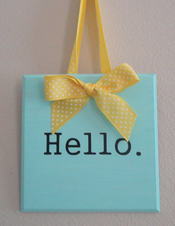 Blue Wooden Plaque Hello Sign with Yellow Polka Dot Ribbon.