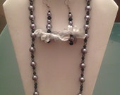 3 piece jewelry set.  Necklace, Dangle earrings and Glittery bar bangle with pearlized beads. Grey and white. Fits most wrists.